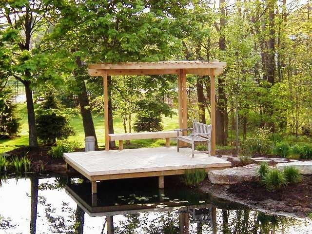 Small deck with bench for lake area?  Not sure we want permanent structure due to water level variations