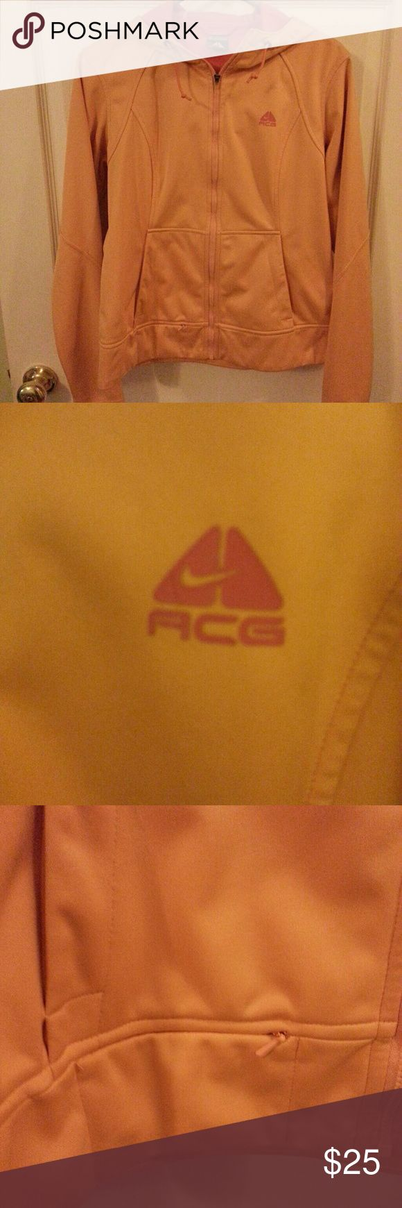 """Ladies jacket Ladies hooded Nike/ACG water resistant jacket with pink lining.  This jacket has a small """"key"""" pocket as well as thumbhole cuffs/sleeves.  It's in like new condition and only worn a few times. Nike/ACG Jackets & Coats Utility Jackets"""