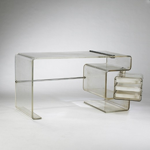 1970s desk USA acrylic, stainless steel 56.5 w x 23.75 d x 30 h inches.This desk features a swiveling drawer case containing three sliding drawers. s2