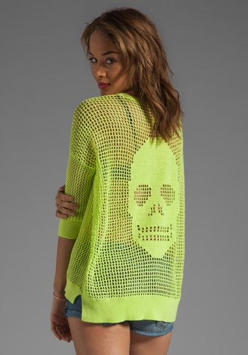 "Edgy filet crochet! And the colorway is called ""Glow worm"" -- can you even try to resist!? (Autumn Cashmere Crochet Skull Sweater)"