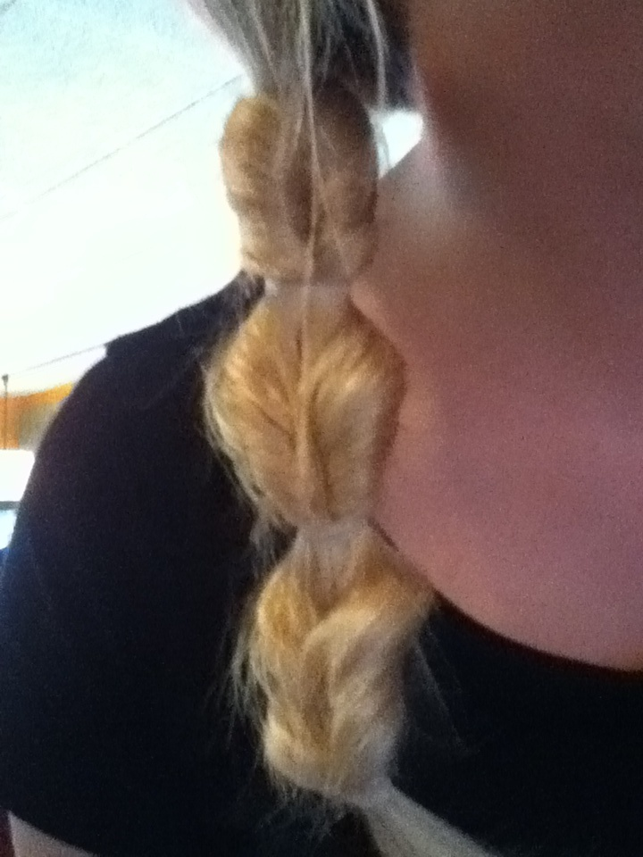 My waitress's hair today! You just take a side ponytail and turn it in and wala!