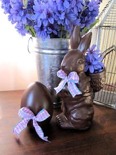 <3 Love this idea. She used brown spray paint and covered plastic easter egg and bunny figure. Looks like chocolate.