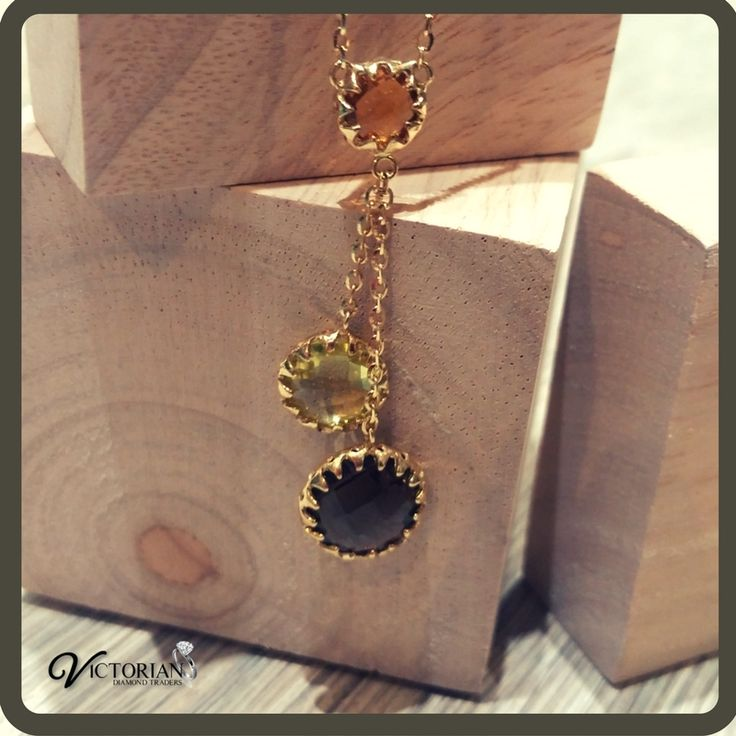 18 ct yellow gold necklace with natural coloured stones!!