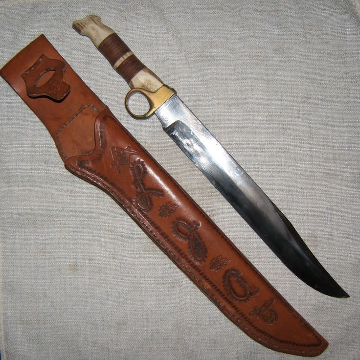 "Handmade Bowie style 11"" high carbon steel blade, brass finger ring bolster, leather washer and elk antler hilts. Hand tooled leather sheath."