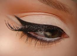 Sharp cat eye with fake lashes.