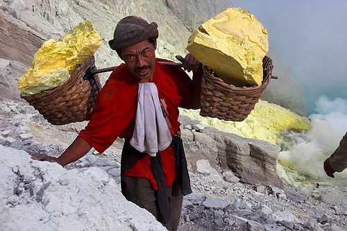 Worker carrying sulphur - Kawah Ijen: