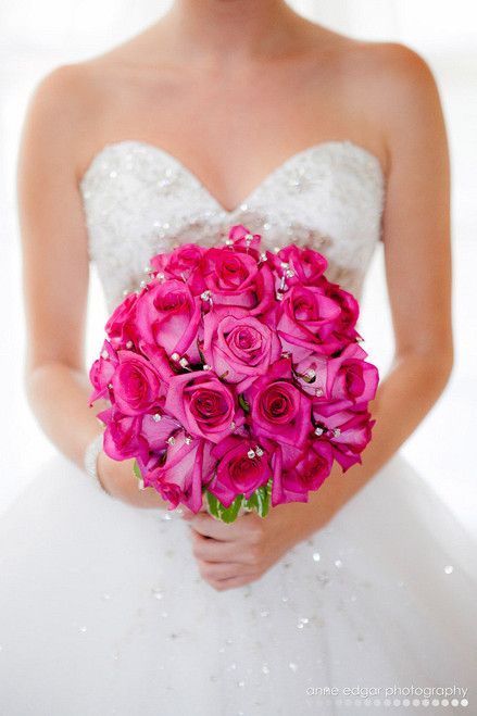 bridal bouquet in vibrant pinks / fuschias and bridesmaids bouquets in all white - do this but smaller and with the one purple in the middle