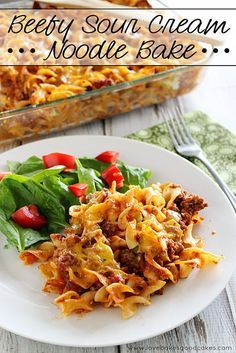 This Beefy Sour Cream Noodle Bake is pure comfort food! Wide egg noodles and a meaty sauce with a creamy middle layer, all topped with Cheddar cheese! #comfortfood #easydinnerideas #pasta