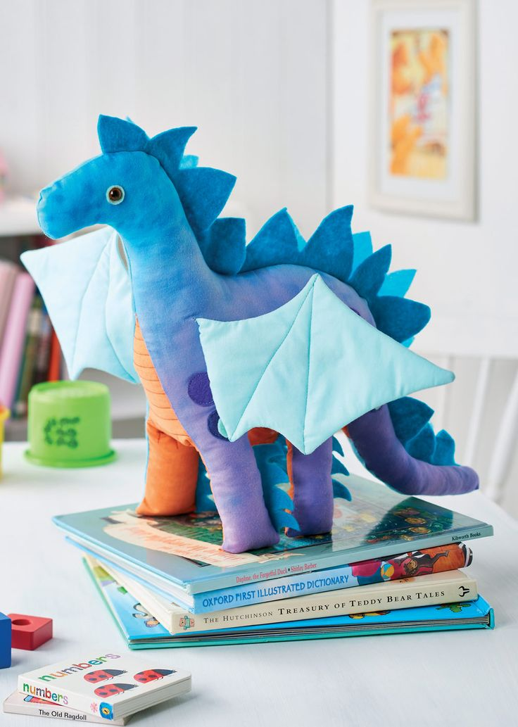 Make this majestic and colourful soft toy dragon, complete with felt spikes and magnificent turquoise wings. The fabric for this gorgeous make has been hand dyed in scrumptious tones of turquoise and purple, but you can choose any combination you wish. Why not opt for shades of pink, for a little girl and add shimmering sequins to the felt spots?