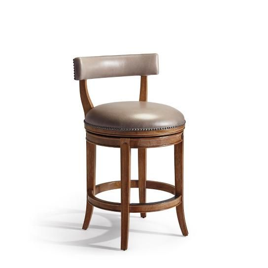 The classic lines and elegant details of the Henning Swivel Counter Stool are a welcome addition to any decor from traditional to transitional. Henning refined silhouette is enhanced with understated curves at the back supports and legs. Seat and backrest are generously padded for guaranteed comfort and upholstered in easy-care linen. 180 swivel.Handcrafted of solid hardwoodSeat and backrest are upholstered in easy-care linen or top-grain corrected leathe and detailed with nailhead…