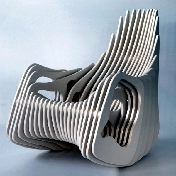 Designer Wooden Rocking Chair With Curved Shapes Of