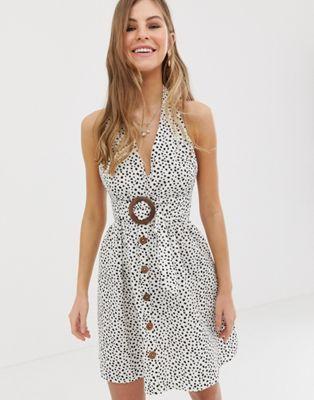 1cf84e1cc9576 ASOS DESIGN halter neck mini button through linen sundress with buckle in  spot