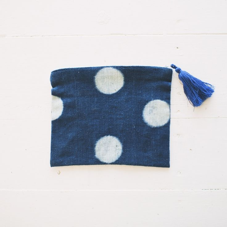Polka dotted mud cloth clutch or cosmetic bag.  Handmade using locally grown Indigo and mud from the Niger River with handmade tassel pull. Handwoven and sewn in Mali, West Africa. 7