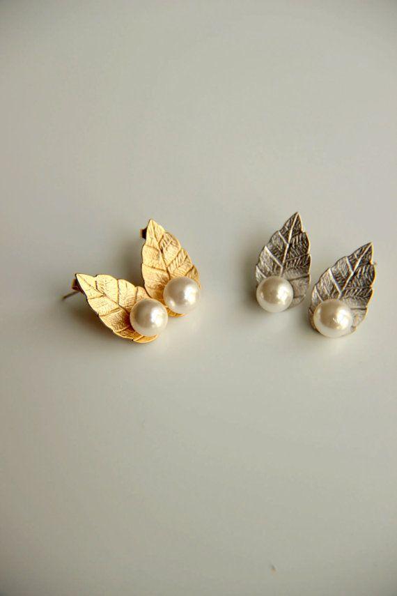 Earrings:Gold and rhodium plated stud earrings by HirasuGaleri
