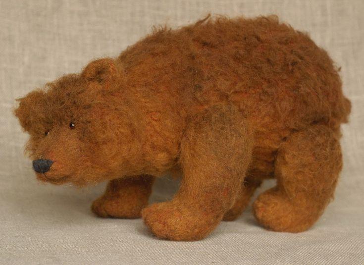 red crouching bear