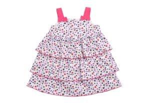 Vestido para bebe niña estampado de florecitas en tonos de lila, fucsia, verde fosforescente y azul oscuro. Escote cuadrado y sin mangas.