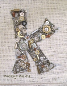 """Initial letter made with leftover washers, screws, bolts, nuts & other bits of hardware ("""",)"""