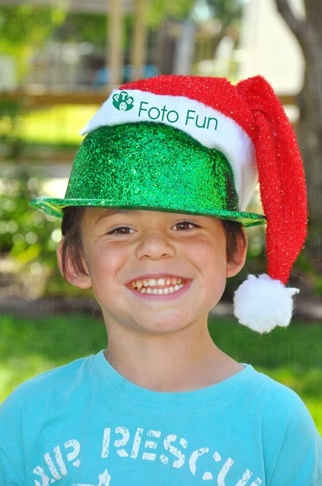 Christmas fun, boy with 2 hats