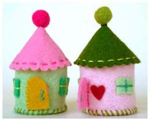 Tiny felt houses to put a little doll in