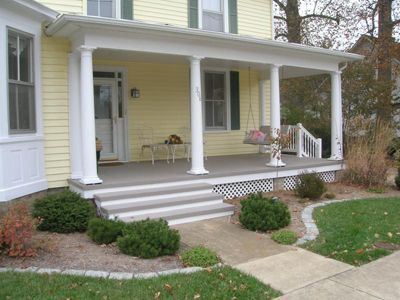 Front porch painted clapboard siding and raw concrete for Concrete patio railing