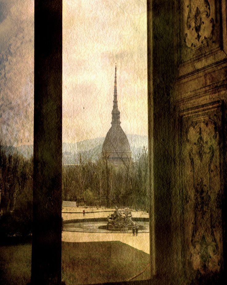 Watching Antonelliana tower from the window - null