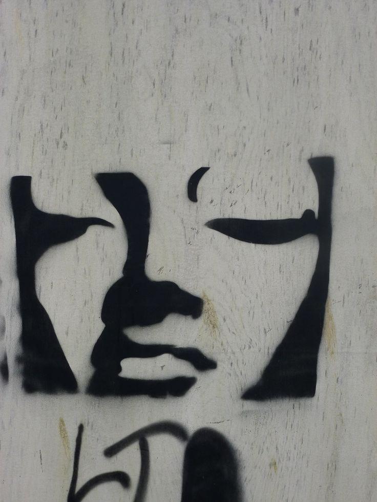 woman on a wall  bridport, dorset 2012