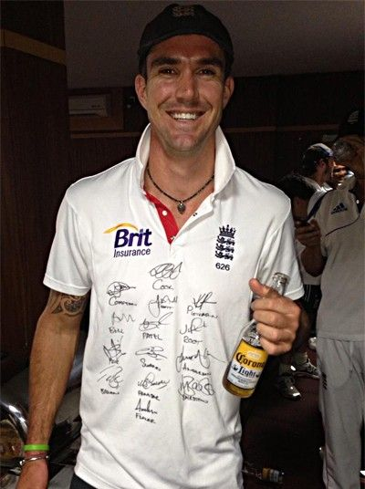 Getting shirty: Kevin Pietersen wearing a shirt decorated with his team-mates signatures. Matt Prior, who tweeted the picture, said @kevinpp24 is so reintegrated he's walking around with all our names on his shirt!  Picture: TWITTER.COM/MATTPRIOR13