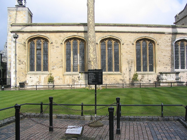 Tower green - the scaffold site  This is where Henry VIII had wives Anne Boleyn, Katheryn Howard, and many others executed. Lady Jane Grey was executed on this spot as well, and their bodies are buried under the altar of the church pictured here, the Chapel of St. Peter ad Vincula.