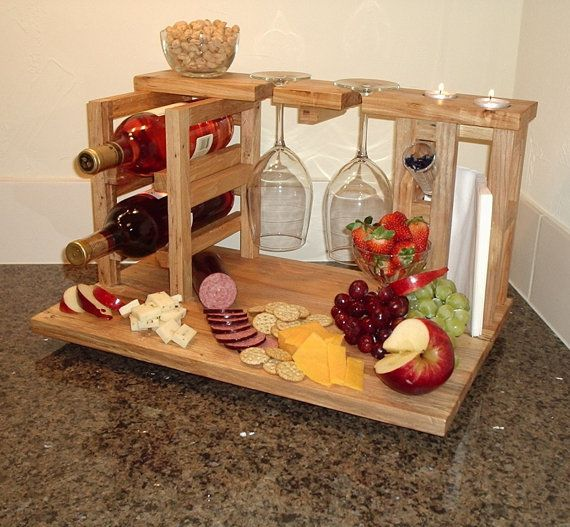I love this!  Wine and cheese party for 2 includes wine rack, glass holders, cheese cutting board made from upcycled solid pecan flooring, Ready to ship. $189.00, via Etsy.