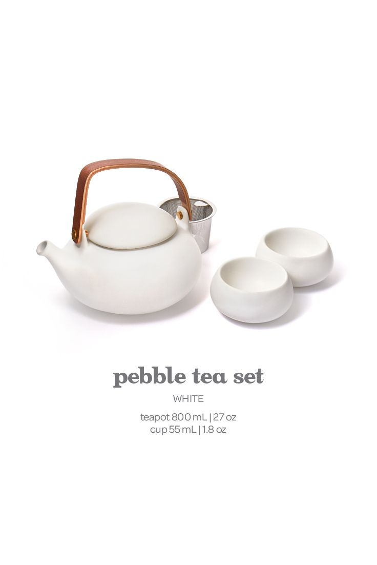 Pebble Tea Set - White. A sleek, modern tea set in matte porcelain and bamboo. Includes infuser.