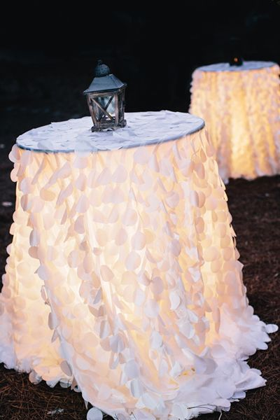 Cocktail tables with textured linens and beautiful lighting