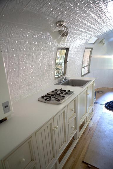 Timeless Airstream Interior Restoration of a 1968 Safari 22' - curved wall option