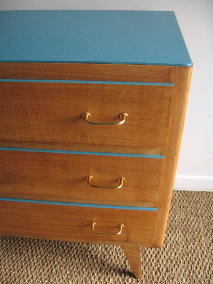 Paint the top and top drawer edges of a dated dresser. I'd update the handles too.