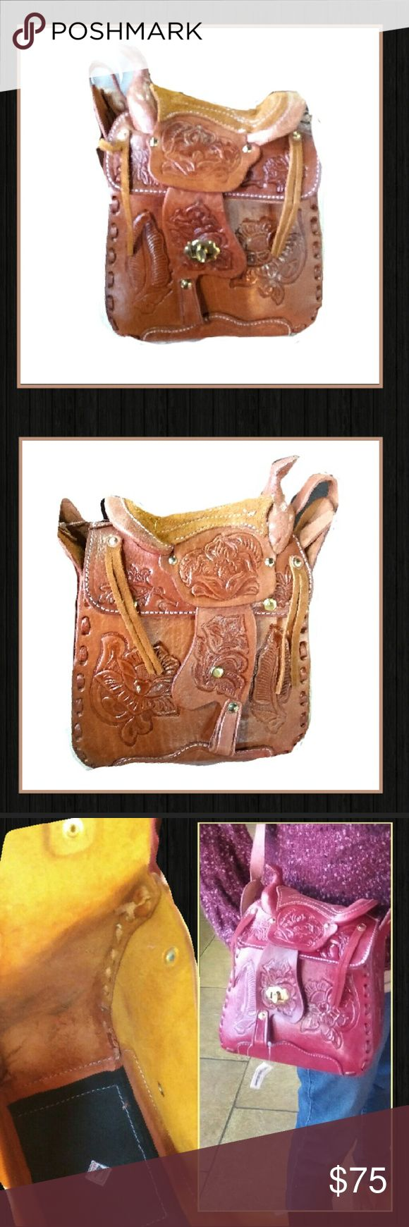 Saddle Bag in Tobacco Brown Saddle Bag in Tobacco Brown! Cute and trendy saddle bag that brings new meaning to saddle bag! It has the actual shape of a real saddle bag up top, embossed leather and awesome details! Make it yours today! We carry this bag in black and also cherry red! Strap can be worn as shoulder or crossbody! boutique Bags