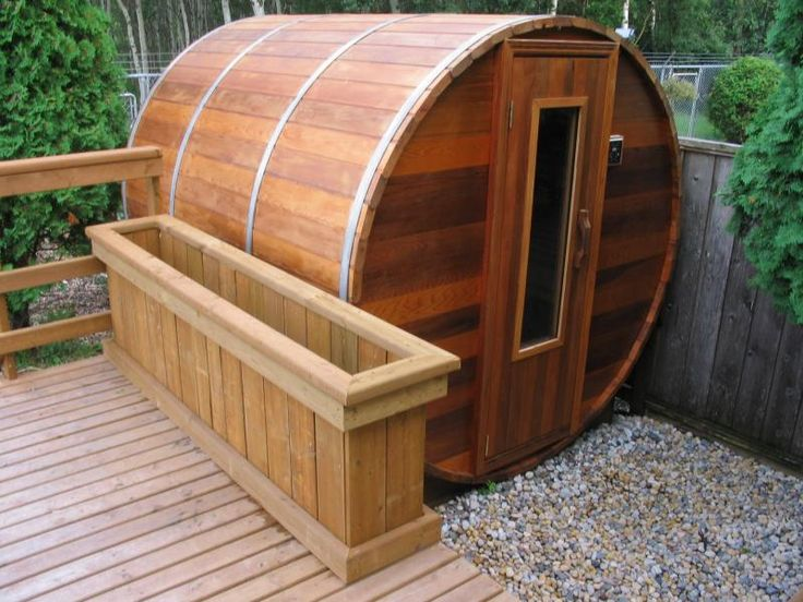 outdoor cedar barrel sauna. electric or log fired.