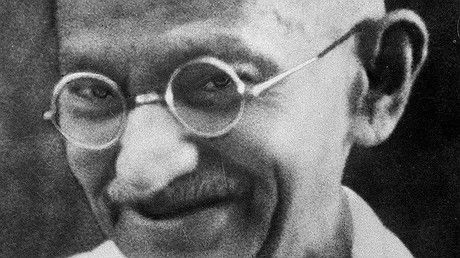 "A portrait of Mohandas ""Mahatma"" Gandhi. Second image: Gandhi during the Salt March."
