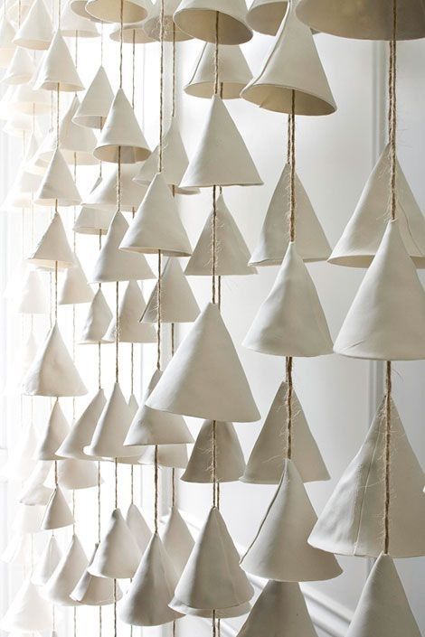 Mud Puppy wind chimes via Etsy | Remodelista wall of ceramic wind chimes from Austin, Texas, artist Jennifer Pritchard