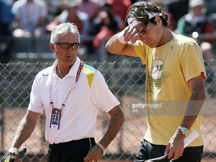 Swiss tennis player Roger Federer (R) listens to his new Spanish coach Jose Higueras (R) during their training session at Jamor Stadium in Lisbon on April 14, 2008 in Estoril. Federer will play vs Belgian Olivier Rochus at the Estoril Open on 15 April 2008.