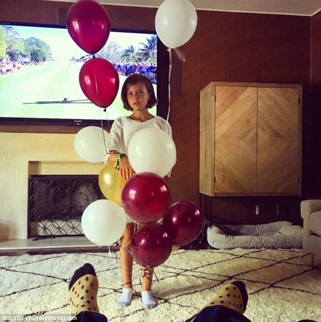 The son of actor Michael Warren later shared a snap of Honor with balloons captioned: 'For...
