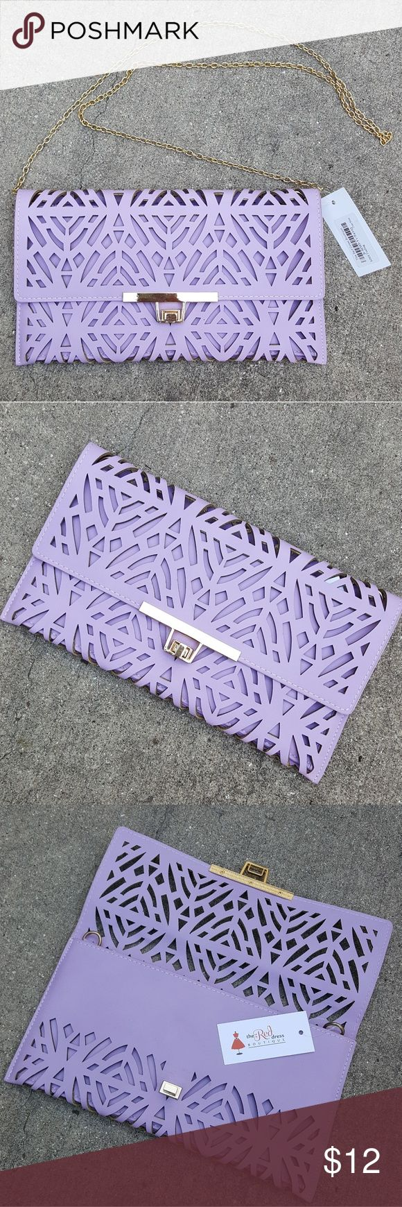 Lasercut lavender/purple clutch / shoulder bag NWT laser cut clutch with removable shoulder chain! Purchased from Red Dress Boutique and never used. Has gold hardware and is in perfect condition! Smoke free, pet friendly home. Red Dress Boutique Bags