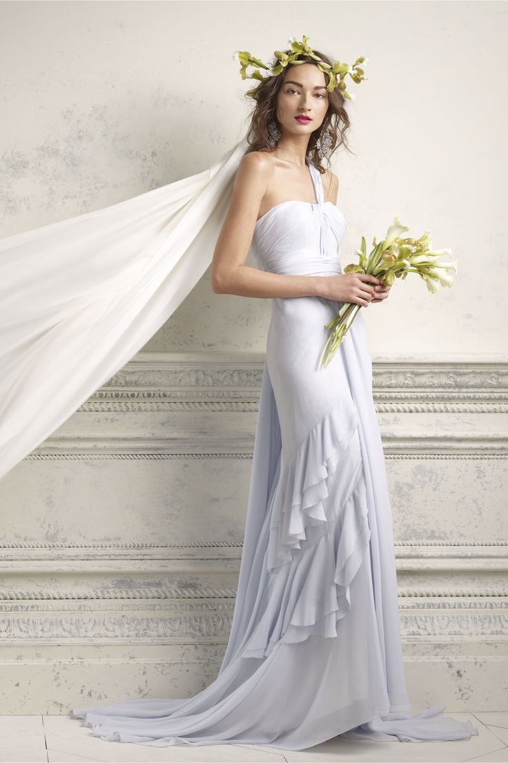Lilac-hued, something blue wedding gown with delicate, frothy layers.