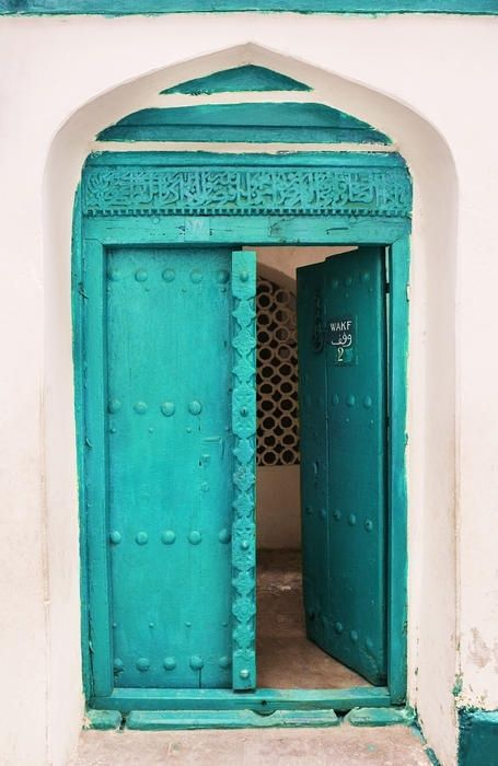 white wall / turquoise door