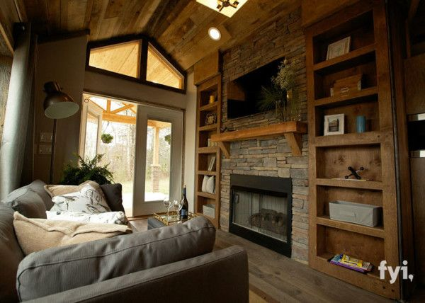 The living room is brimming with cool  contemporary Don  t Mess With Texas style  It has a big  dramatic stone fireplace and mantle  big wooden built in cabinets  big stunning entryway  and a big feeling of space