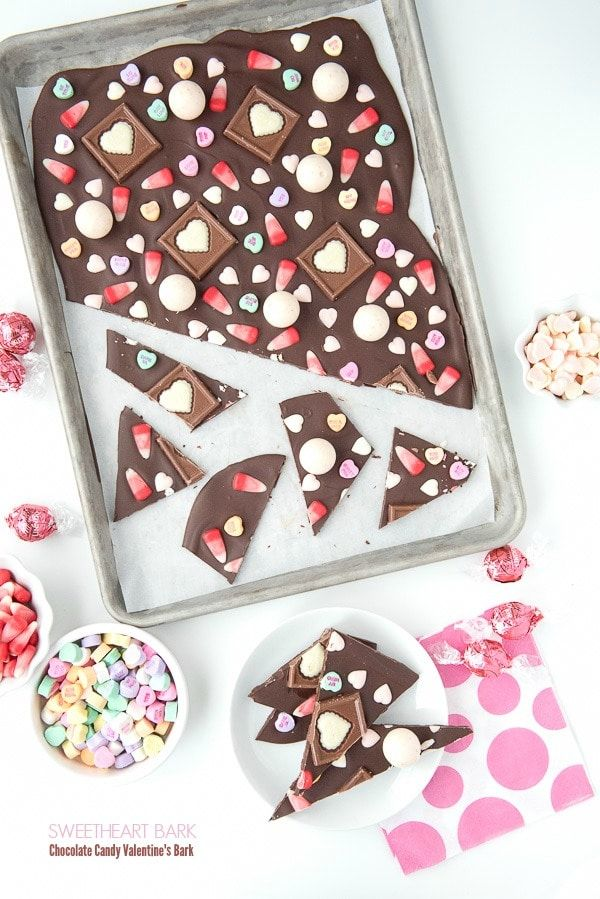 Sweetheart Bark: Valentine's Candy Chocolate Bark. Easy to make in 15 minutes. A thin chocolate layer covered with Valentine's candy. Great to celebrate or use up leftover candy! #ValentinesDay #chocolate #bark  via @boulderlocavore