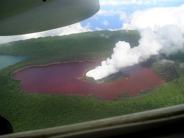 Ambae's Crater Lakes (Vanuatu). 'Ambae is actually Vanuatu's largest  volcano. However, instead of a smoking caldera, it's topped with three crater lakes which change dramatically depending on the level of activity. Lake Vui has experienced interesting activity in recent decades, including wild colour changes (from blue to red to blue again) and the emergence of a cone from its centre.' http://www.lonelyplanet.com/vanuatu