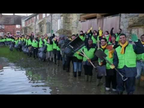 World Mission Society Church of God volunteers help clean up after floods