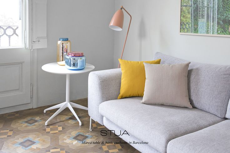 STUA Marea table in white & the new basic cushions make this space in Barcelona contemporary.