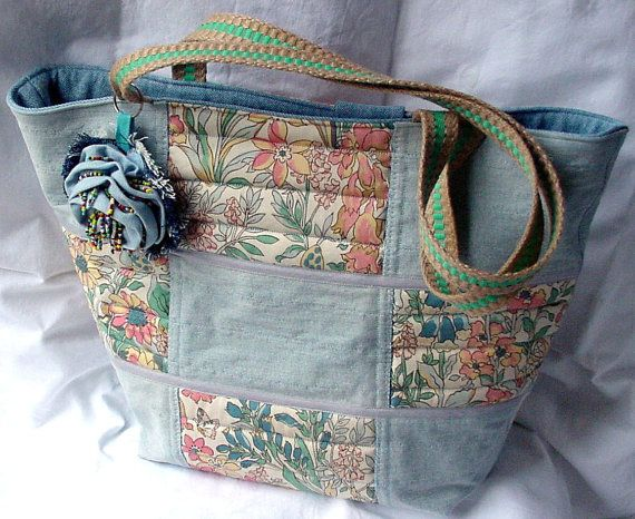This patchwork quilted tote bag will certainly get noticed, handmade in a lovely bleachwash denim and English garden floral print. The repurposed