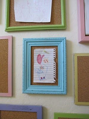 Frames filled with cork board for kids artwork and writings- instead of pinning on fridge, hang on the wall and have constant changing wall art. Cute idea from 3meadowlakecottage.
