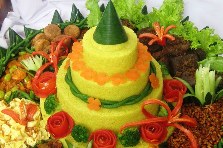 """Nasi Tumpeng    The """"Nasi Tumpeng"""" is special rice made like a shape of a cone or a traditional Indonesian food that has become a tradition  in most important celebrations. The """"Nasi Tumpeng"""" is presented as the highlight food in traditional ceremonies, such as weddings, dedications, thanksgiving, and other important events.    Details: http://describeindonesia.com/en/culinary/item/155-the-rice-cone-or-%E2%80%9Cnasi-tumpeng%E2%80%9D,-traditional-rice-cone,-the-pride-of-indonesia.html"""